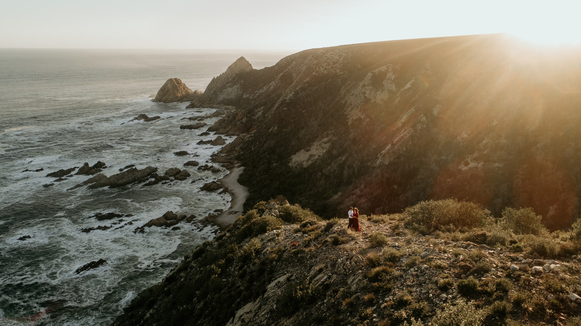 drone footage of couple on coastline june richards photography garden route weddings and engagements